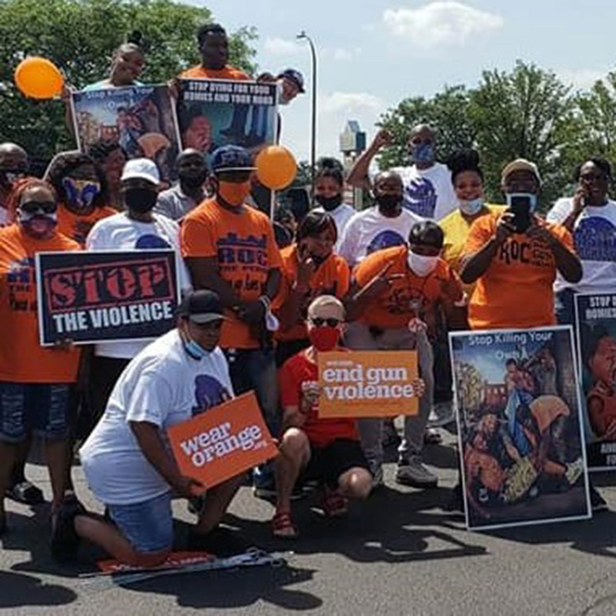 Rise Up Rochester, Inc. at a Wear Orange event
